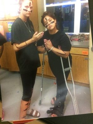 Emma Kypuros on crutches